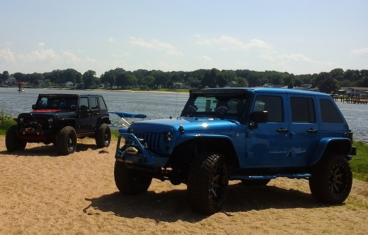 Jeeps on the shoreline