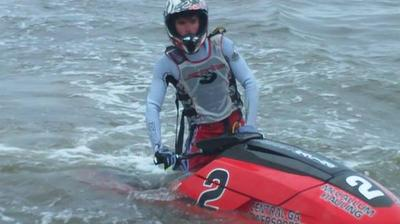 Racers power through the surf!