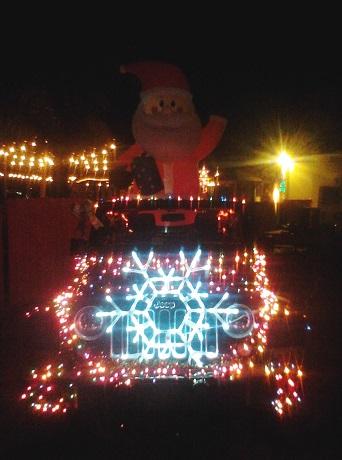 Santa on lighted jeep