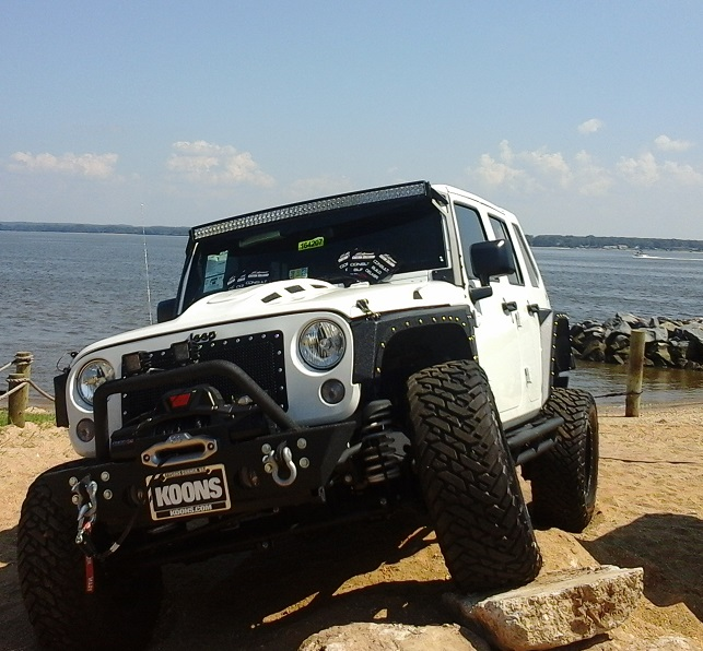 white jeep on rocks